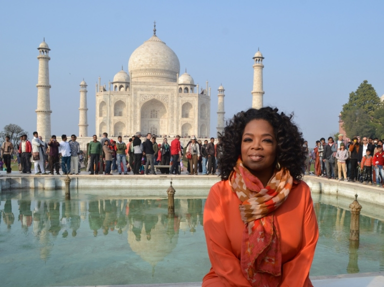 <p>Oprah Winfrey poses in front of the Taj Mahal on January 19, 2012.</p>