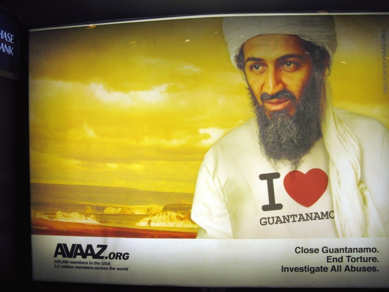 <p>A billboard with Osama bin Laden wearing an 'I love Guantanamo' t-shirt is on display at Farragut North Metro Station in Washington D.C. in September 2009.The billboard is an advertisement from Avaaz.org, an organization that launched a metro billboard campaign to remind policymakers that torture is a top recruiting tool for al-Qaeda leader Osama bin Laden and his network.</p>