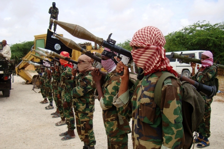 <p>Militants belonging to Somalia's Al Qaeda-inspired Al Shabaab Islamists stand in formation on October, 21, 2010 during a show of force in Somalia's capital Mogadishu.</p>
