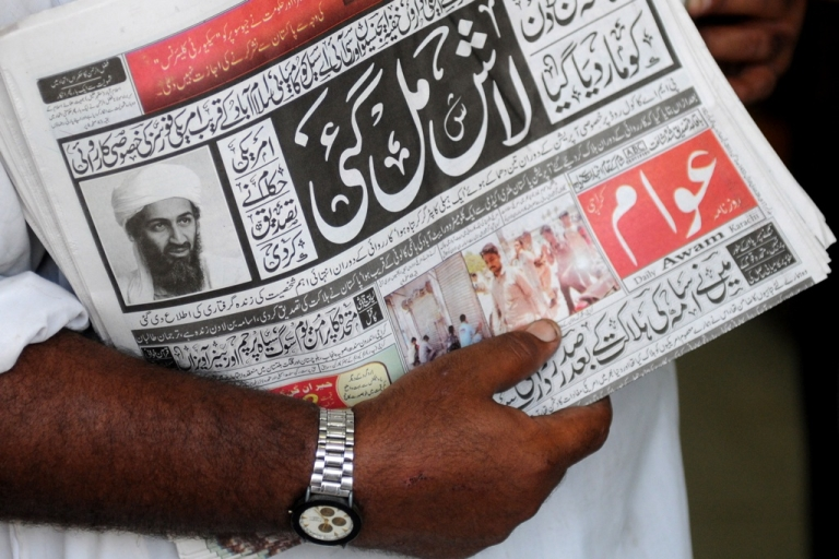 <p>A Pakistani newspaper with headlines of Osama bin Laden's death on a street in Karachi on May 2, 2011. Bin Laden was killed in a highly sensitive intelligence operation in the suburbs of Abbottabad, 30 miles northwest of the Pakistani capital Islamabad, it was announced on May 2, 2011.</p>