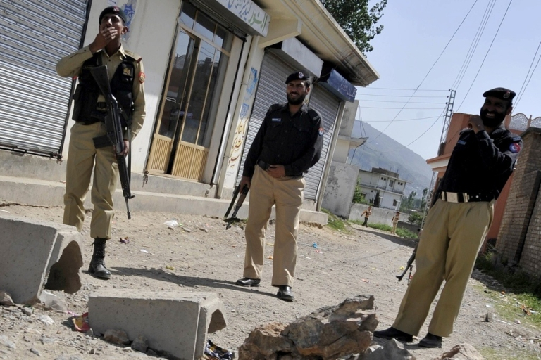 <p>Pakistani military and police officials cordon off a street leading to the final hideout of Osama Bin Laden in Abboattabad on May 9, 2011. Pakistan announced an official probe into the question of how bin Laden could live in a garrison city.</p>