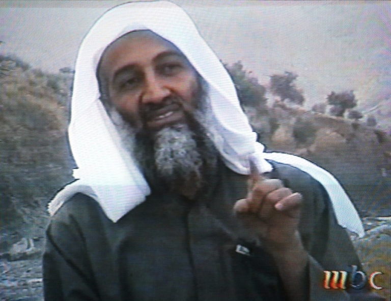 <p>This frame grab from the Saudi-owned television network MBC (Middle East Broadcasting Center) shows alleged terror mastermind Osama bin Laden gesturing an undated videotape broadcast by the Dubai-based MBC April 17, 2002.</p>