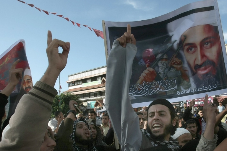 <p>Palestinian Sunni Muslim fundamentalists hold up images of Osama bin Laden during a protest in Gaza city on May 7, 2011, denouncing the U.S. Navy SEALs operation in which bin Laden was killed in the city of Abbottabad in northeastern Pakistan on May 2. But many Muslims argue that bin Laden's death is an opportunity for Muslims to renounce violence.</p>
