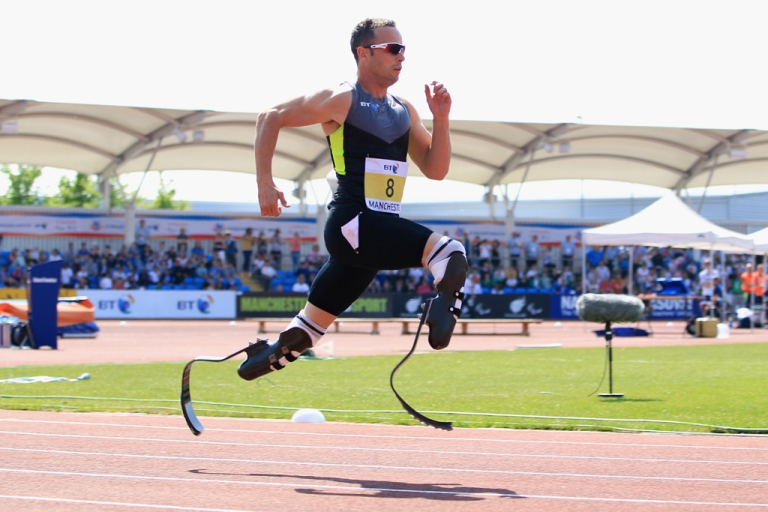 <p>Oscar Pistorius of South Africa wins the men's 200m at the Paralympic World Cup on May 22, 2012, in Manchester, England.</p>