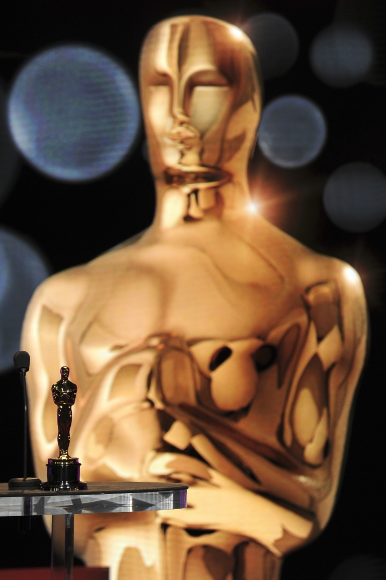 <p>An Oscar stands on the podium in front of a projection of an Oscar before the start of the 84th Academy Awards Nominations Announcement, January 24, 2012 at the Academy's Samuel Goldwyn Theater in Beverly Hills, California.</p>