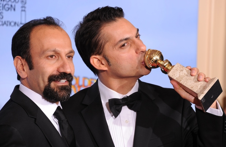 <p>Winners for Best Foreign Language Film 'A Separation' ('Jodaeiye Nader az Simin', Iran) Director Asghar Farhadi and actor-screenwriter Peyman Moaadi (R) poses with the trophy at the 69th annual Golden Globe Awards at the Beverly Hilton Hotel in Beverly Hills, California, January 15, 2012.  The film was nominated for an Oscar this morning.</p>