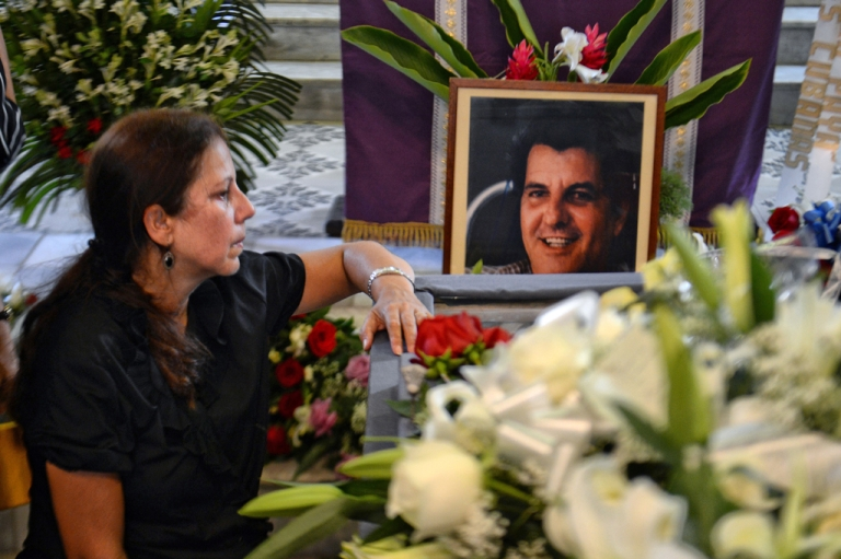 <p>Ofelia Acevedo, widow of Cuban dissident Oswaldo Paya, mourns during his funeral, at Salcador del Mundo church in Havana.</p>