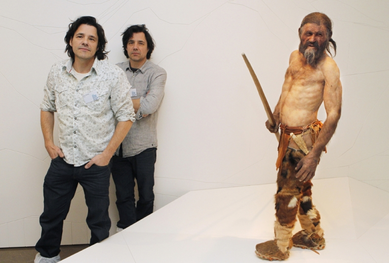 <p>Dutch artist Adrie Kennis (L) and Alfons Kennis, the two artists who made the reconstruction of a mummy of an iceman named Oetzi, pose near the statue displayed at the Archeological Museum of Bolzano on February 28, 2011 during an official presentation. The model is based on three-dimensional images of the mummy's skeleton as well as the latest forensic technology.</p>