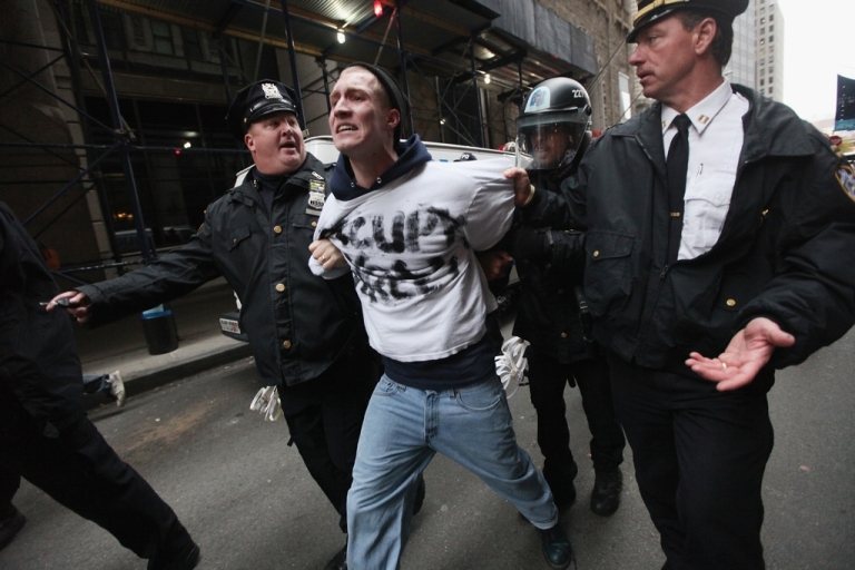 <p>Occupy Wall Street protester Henry Cames is arrested by police a few blocks away from the New York Stock Exchange on Nov. 17, 2011, in New York City. Hundreds of protesters attempted to shut down the New York Stock Exchange today, blocking roads and tying up traffic in Lower Manhattan.</p>