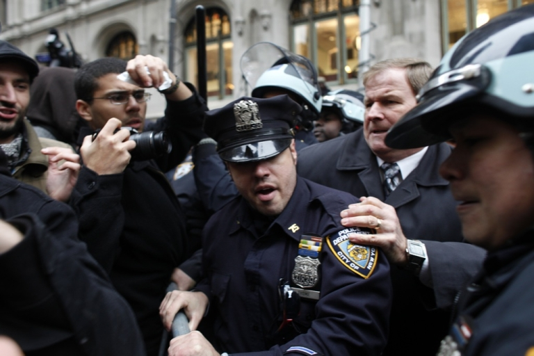 <p>A protester affiliated with Occupy Wall Street is arrested a few blocks away from the New York Stock Exchange on Nov. 17, 2011, in New York City.</p>