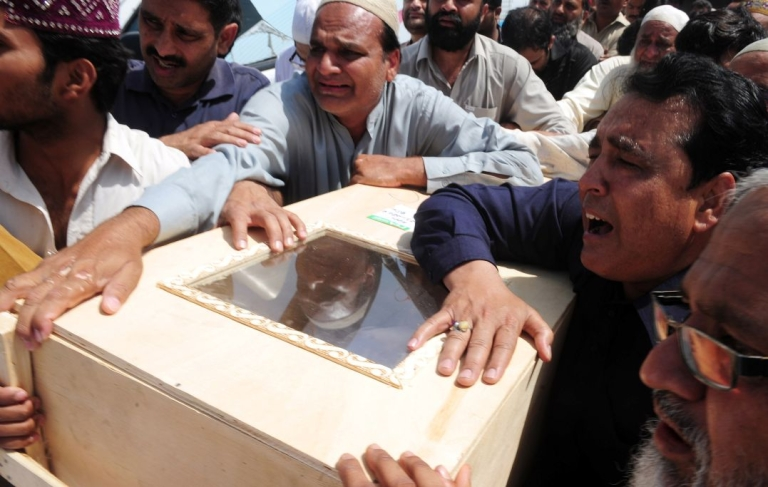 <p>Mourning relatives in Karachi carry the coffin of a passenger killed in the Bhoja Air accident.  All 127 people on board died when the Boeing 737 from Karachi crashed and burst into flames as it attempted to land at Islamabad's airport on Apr. 20.</p>