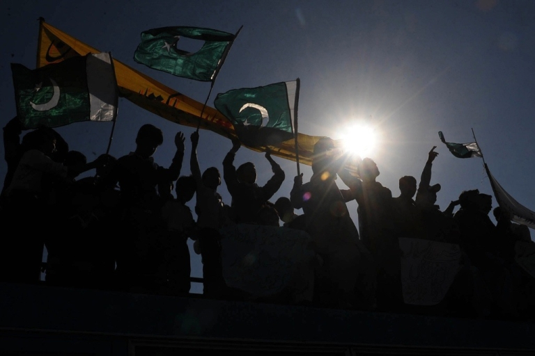 <p>Pakistani students wave national flags in Lahore on Nov. 30, 2011 in protest of the cross-border NATO air strike that killed two-dozen Pakistani troops.</p>