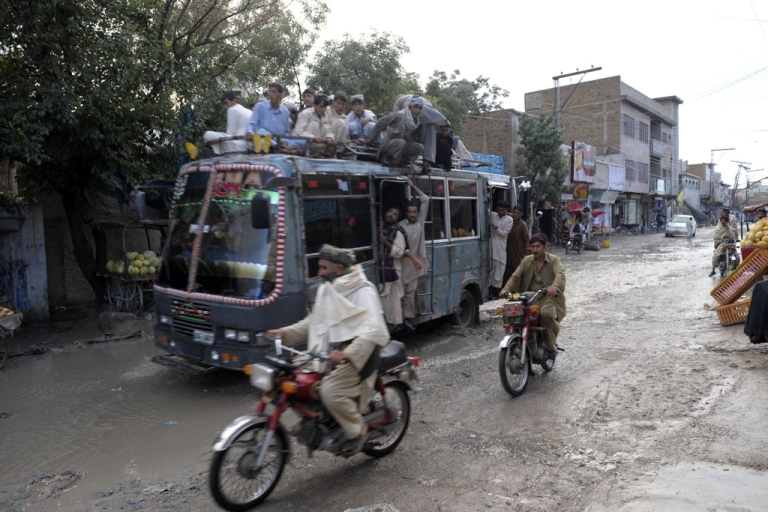 <p>Pakistani commuters travel on an overloaded passenger bus in Quetta, Pakistan, on Sept. 5, 2011.</p>