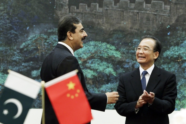 <p>Pakistan's Prime Minister Yusuf Raza Gilani talks to China's Premier Wen Jiabao during a singing ceremony at the Great Hall of the People in Beijing on May 18, 2011.</p>