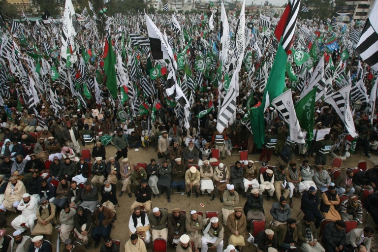 <p>Activists belonging to Pakistan Islamist groups and political parties wave flags at the Pakistan Defense Council (PDC) rally in Rawalpindi on Jan. 22, 2012.</p>