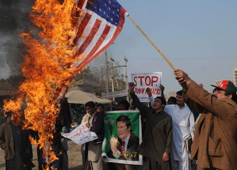 <p>A Pakistani protester burns a US flag in the city of Multan during a demonstration last month against US drone strikes in Pakistani tribal areas.</p>
