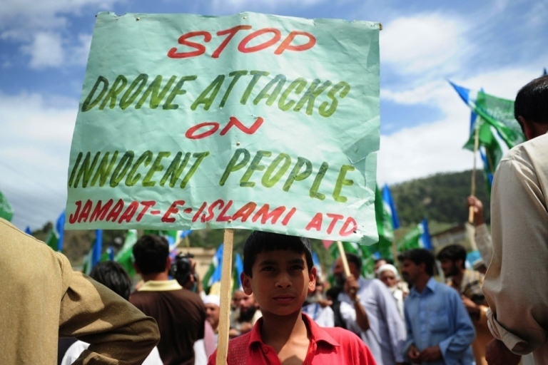 <p>An activist in Abottabad, Pakistan holds a placard during an anti-U.S. protest in May 2011.</p>