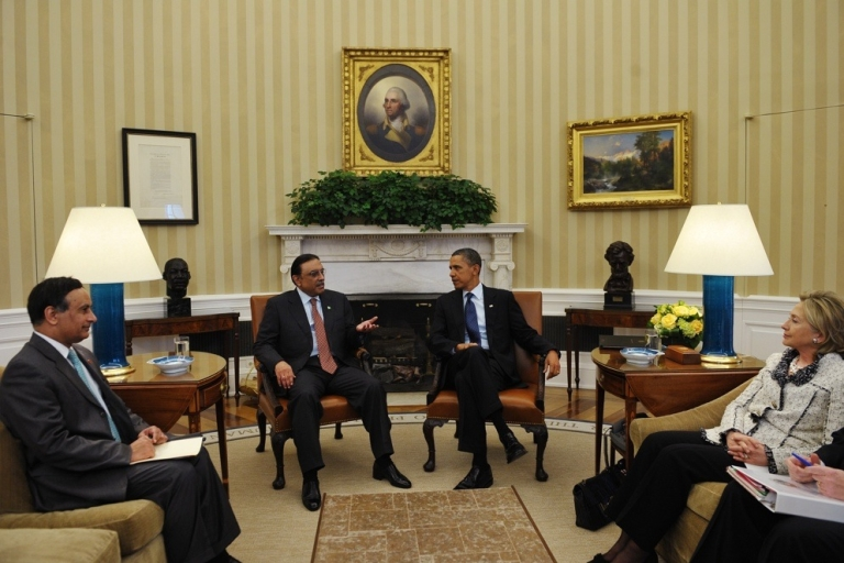 <p>Pakistan President Asif Ali Zardari speaks at a meeting with US President Barack Obama on Jan. 14, 2010 in the Oval Office of the White House. Pakistan's ambassador to the US, Husain Haqqani, and US Secretary of State Hillary Clinton look on.</p>