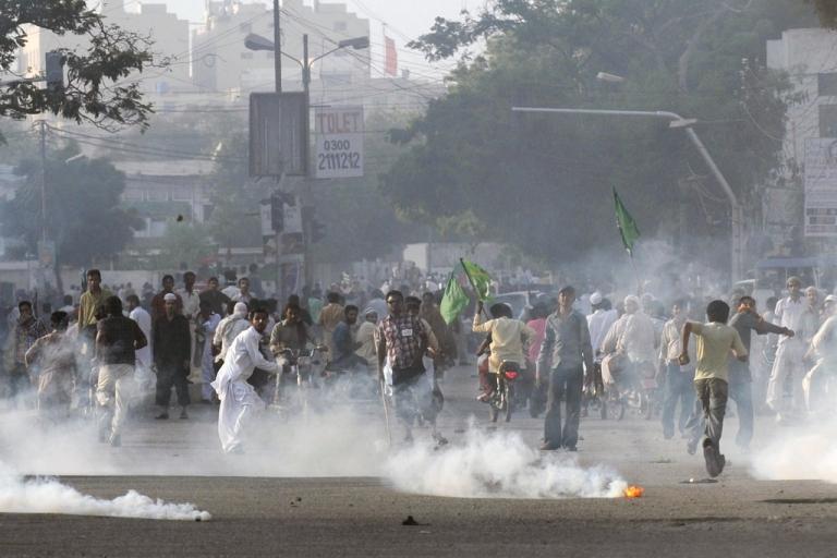 <p>Pakistani demonstrators disperse after police fire tear gas in Karachi on Sept. 21, 2012.</p>