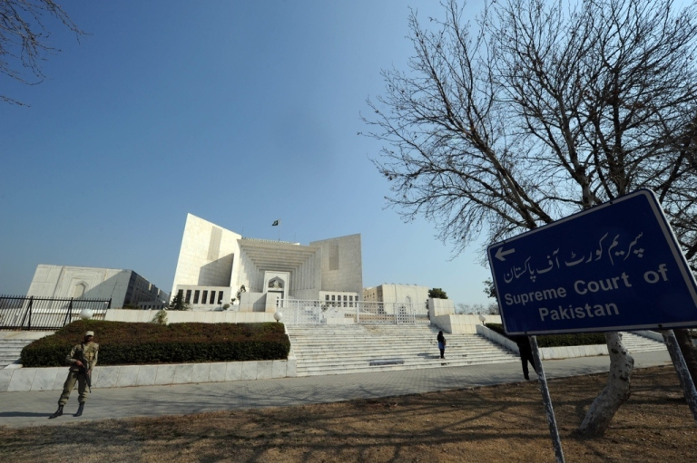 <p>A Pakistani soldier stands guard outside the Supreme Court building in Islamabad on Feb. 10, 2012.</p>