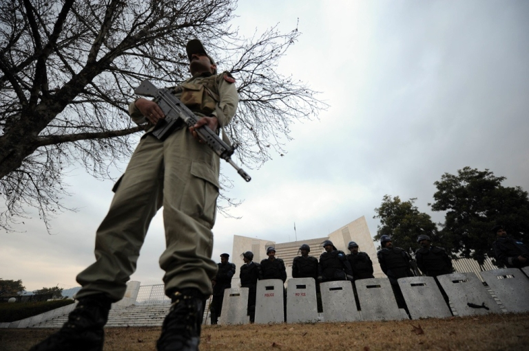 <p>Pakistani security personnel stand guard outside the Supreme Court building during a hearing in Islamabad on Jan. 19, 2012.</p>