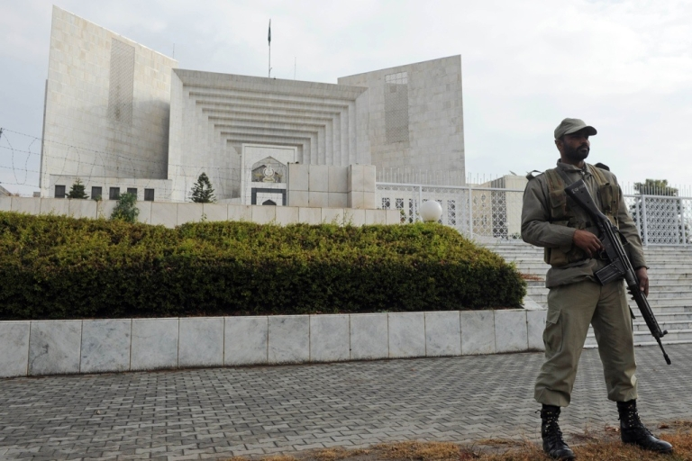 <p>A Pakistani paramilitary soldier keeps watch outside the Supreme Court building during a high profile corruption case hearing in Islamabad on Jan. 16, 2012.</p>