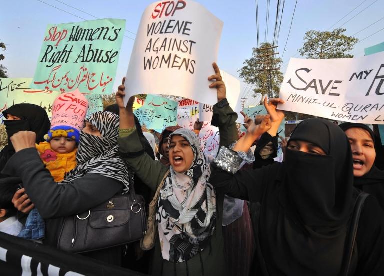 <p>Supporters of Tehrik-e-Minhaj ul Quran, an Islamic Organisation protest against 'honour killings' of women in Lahore on November 21, 2008.</p>