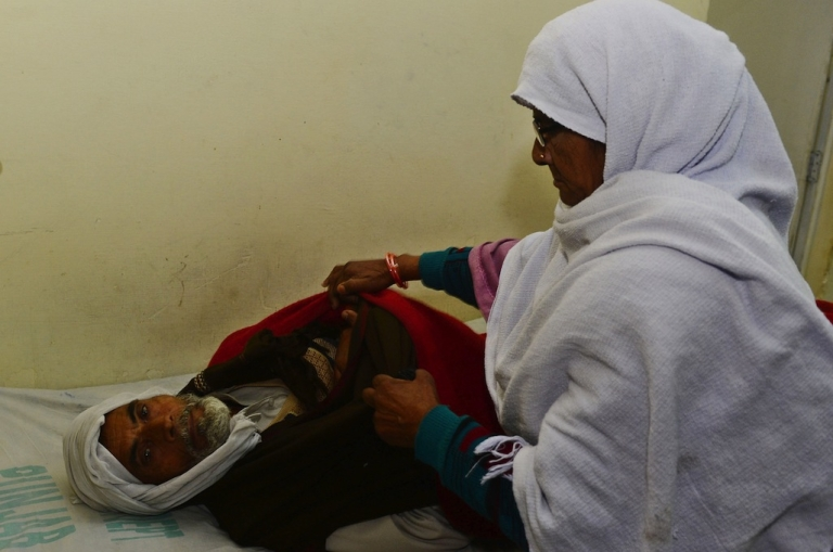 <p>A Pakistani relative looks over patients who consumed toxic cough syrup are treated in a ward of a hospital in Gujranwala on Dec. 29, 2012.</p>