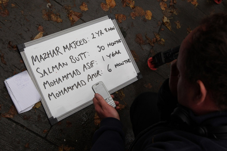 <p>LONDON, ENGLAND - NOVEMBER 03: A television news producer writes the sentences received by Pakistan cricketers and their agent down on a board outside Southwark Crown Court on November 3, 2011 in London, England.</p>