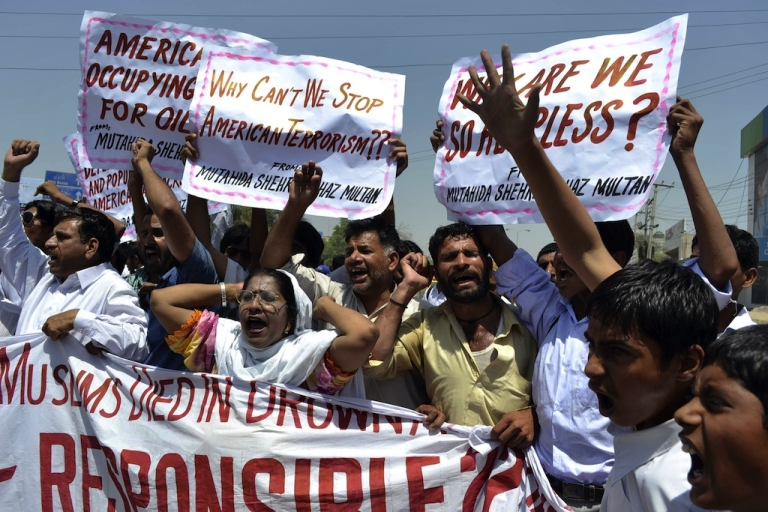 <p>Pakistani protesters belonging to United Citizen Action shout anti-U.S. slogans during a protest in Multan on April 22, 2011, against the U.S. drone attacks in Pakistani tribal areas.</p>