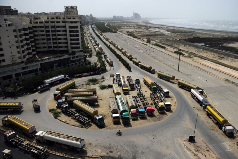 <p>Fuel tanker trucks, used to transport fuel to NATO forces in Afghanistan, are seen parked along a road in Pakistan's port city of Karachi on June 12, 2012. Pakistan reopened NATO supply routes into Afghanistan on July 5, 2012, for the first time in seven months.</p>