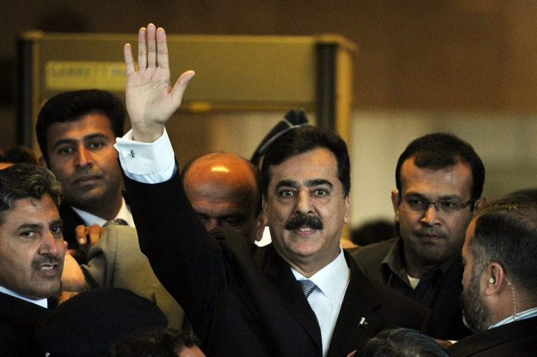 <p>Pakistani Prime Minister Yousuf Raza Gilani waves as he arrive at the Supreme Court in Islamabad on February 13, 2012.</p>