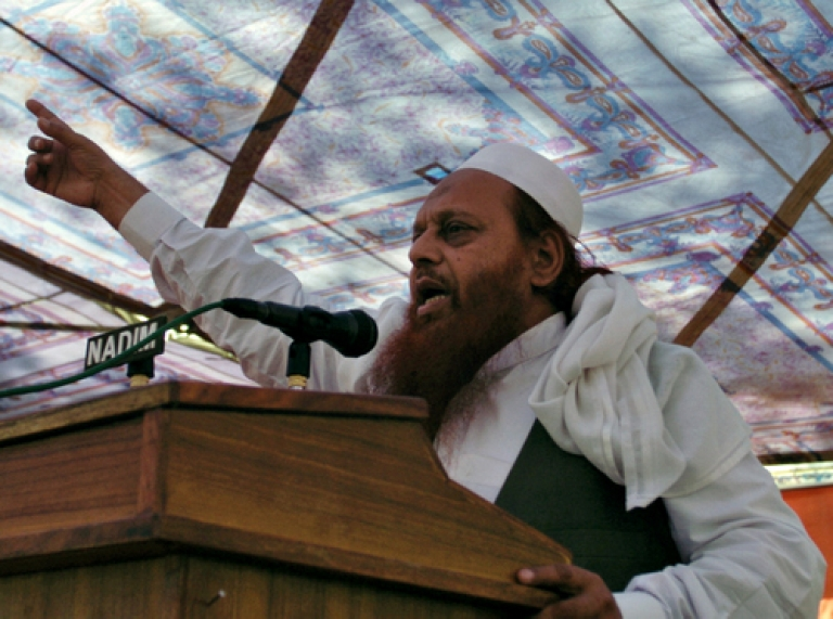 <p>Abdul Wahid Kashmiri, a Lashkar-e-Taiba commander, speaks during a rally in Muzaffarabad on October 27, 2010, to mark Black Day. Kashmiris on both sides of the Line of Control are observing Black Day, which marks the anniversary of Indian troops arriving in Kashmir on October 27, 1947, after the Himalayan region's Hindu ruler requested help to fend off an invasion by Pakistan-backed tribesmen.</p>