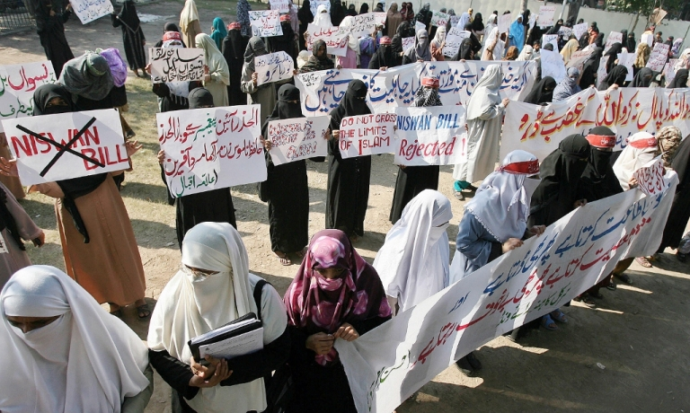 <p>Pakistani women protest the passage of a women's rights bill modernizing laws affecting rape victims Dec. 1, 2006 in Lahore, Pakistan. The country faces severe challenges to solving its sexual violence crisis from religious fundamentalists.</p>