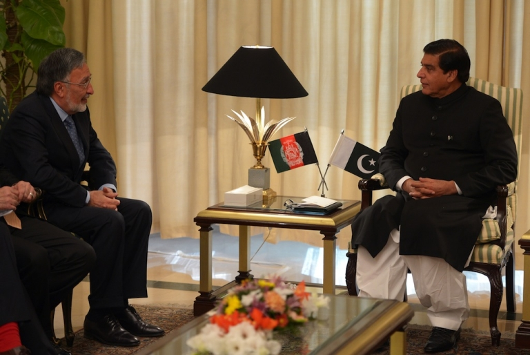 <p>Pakistani Prime Minister Raja Pervez Ashraf (R) talks with Afghan Foreign Minister Zalmai Rassoul during a meeting in Islamabad on November 30, 2012. Afghanistan sent a second high-level delegation in weeks to Islamabad to press for the release of Taliban prisoners in a bid to kick start peace efforts, officials said.</p>
