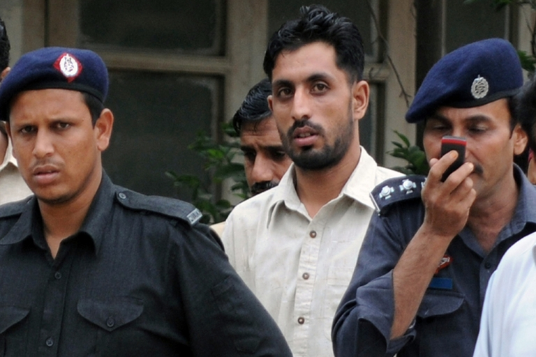 <p>Pakistani paramilitary soldier Shahid Zafar, who shot unarmed youth Sarfaraz Shah at point blank range on June 8, is escorted to court in Karachi on August 12, 2011.</p>