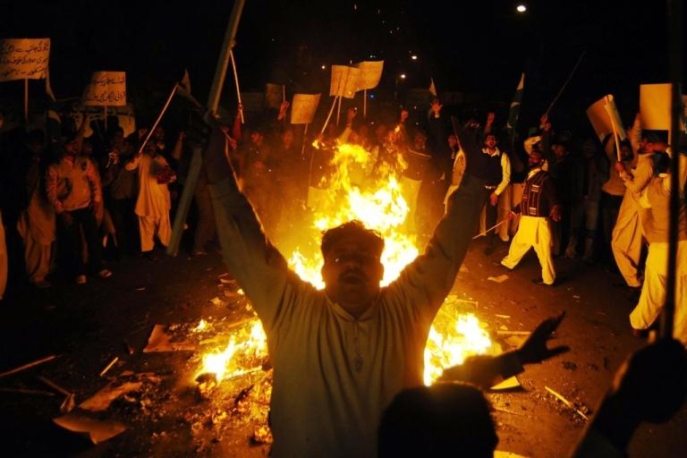 <p>Pakistanis burn NATO in effigy in a protest against NATO strikes.</p>