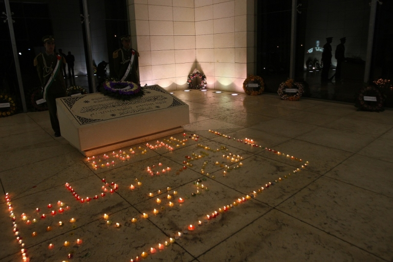 <p>Flower wreathes and candles decorate the guarded gravesite of late Palestinian leader Yasser Arafat in the West Bank city of Ramallah in Nov. 2011.  The Palestinian Authority now want his body exhumed and tested for signs of polonium poisoning.</p>