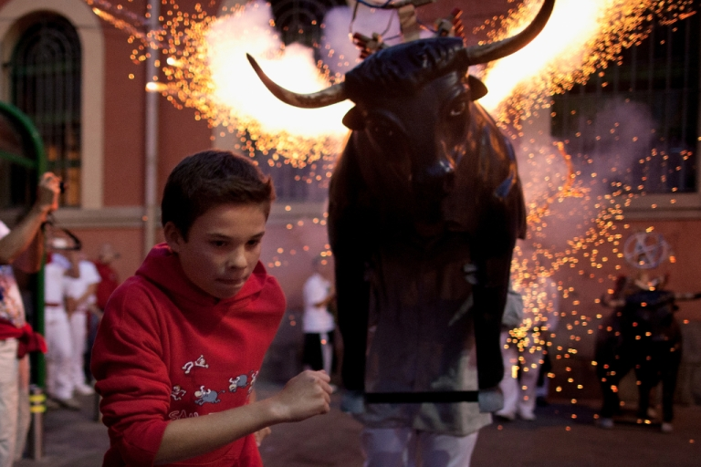 <p>A Toro del Fuego, flaming bull, is run through the streets of Pamplona on the second day of the San Fermin running of the bulls on July 8, 2012 in Pamplona, Spain. Pamplona's famous Fiesta de San Fermin, which involves the running of the bulls through the historic heart of Pamplona for eight days starting July 7.</p>