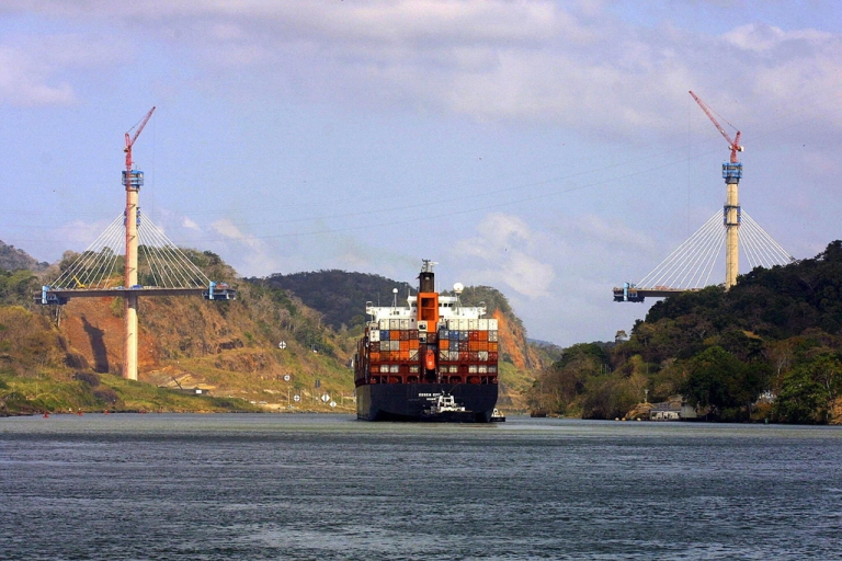 <p>A cargo ship heads to the Atlantic Ocean, passing by the Centennial Bridge.</p>