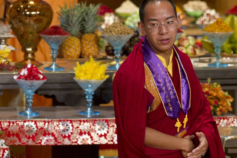 <p>The Panchen Lama, the second highest Tibetan Buddhist leader, walks on stage during a ceremony worshipping the Buddha's parietal bone relic in Hong Kong on April 25, 2012.</p>
