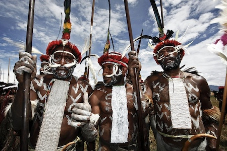 <p>Papuanese tribal men pose for a photograph during the Baliem Valley Festival on August 9, 2010 in Wamena, Indonesia.</p>