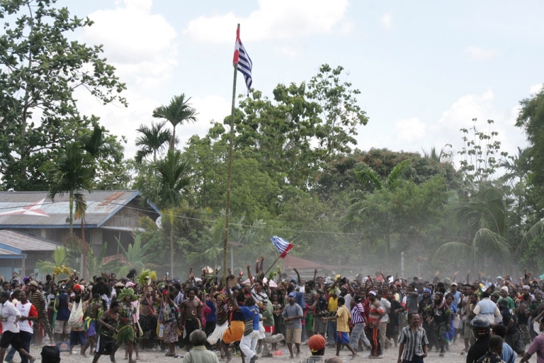 <p>It's not the first time the Indonesian province of Papua has been rocked by violence. Here Papuan demonstrators erupt in a short-lived celebration as they raise the banned Morning Star flag on a bamboo pole in Timika on Dec. 1 2011, the 50th anniversary of the region's claim to independence. Indonesian police and troops opened fire soon after.</p>
