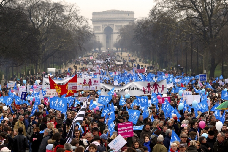 <p>People take part in a protest organized by French far-right party Front national (FN) party against same-sex marriage in Paris on Jan 13, 2013.</p>
