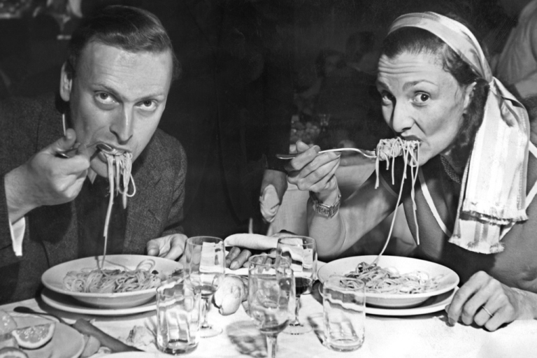 <p>The late violinist Yehudi Menuhin eating pasta in an earlier age of austerity - just after the war in Venice.</p>