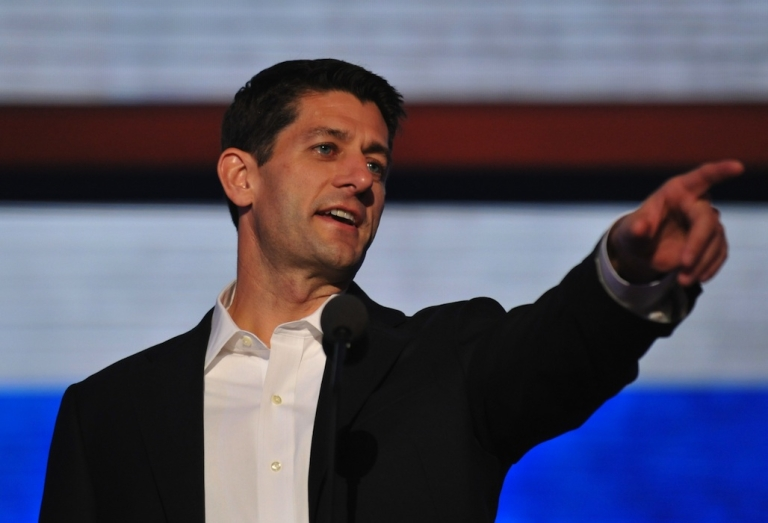 <p>GOP Vice presidential nominee Paul Ryan points during a sound check at the Tampa Bay Times Forum in Tampa, Florida, on August 29, 2012 before the day's Republican National Convention events.</p>