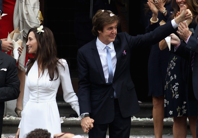 <p>Paul McCartney and Nancy Shevell leave the Marylebone Registry Office after their civil ceremony marriage on October 9, 2011 in London, England. The Marylebone registry office was where McCartney married his first wife, Linda.</p>