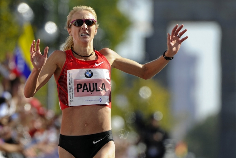 <p>Paula Radcliffe crosses the finish line of the women's event of the 38th Berlin Marathon on September 25, 2011.</p>