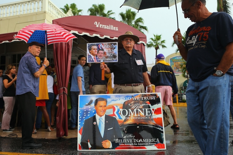 <p>MIAMI, FL - SEPTEMBER 22: Supporters of Republican vice presidential candidate, U.S. Rep. Paul Ryan (R-WI) and Presidential candidate Mitt Romney are seen outside during a Ryan campaign stop at Versailles restaurant in the Little Havana neighborhood on September 22, 2012 in Miami, Florida. Ryan continues to campaign for votes across the country.</p>