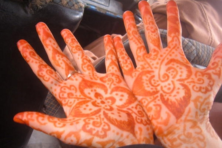 <p>Returned Volunteer Stacey Ferguson gets Henna done on her hands during her time working at as Maternal and Child Health volunteer in Morocco, 2005-2007.</p>